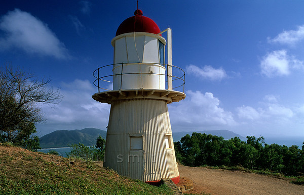 [AUSTRALIA.QUEENSLAND 9879] 'Lighthouse on Grassy Hill near Cooktown.'  From the top of Grassy Hill, next to Cooktown in Far North Queensland, captain Cook looked out over the Coral Sea after his ship was repaired. He intended to find a route to the open sea through the coral riffs. Nowadays a lighthouse stands on Grassy Hill. Photo Paul Smit.