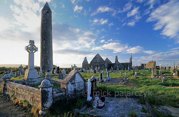 [IRELAND.GALWAY 21880] 'Round tower at Kilmacduagh.'  	Medieval round tower and ruins at the monastic site of Kilmacduagh, east of Gort. Photo Mick Palarczyk.