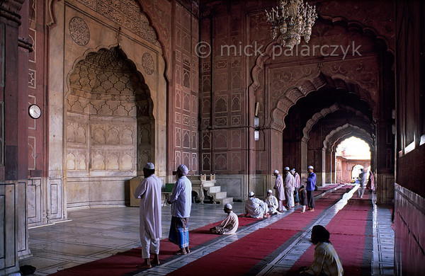 [INDIA.UTARPRADESH 27171] 'Delhi's Jami Masjid mosque.'  	Worshippers are praying in the eastern gallery of the Jami Masjid Mosque in Delhi. The mosque was commissioned by the Mughal emperor Shah Jahan (builder of the Taj Mahal) and completed in the year 1656. Photo Mick Palarczyk.