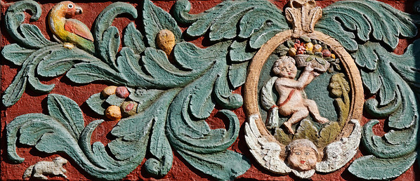 """[GERMANY.HESSEN 29313] 'Angels in Butzbach.'  In Butzbach a woodcarving on the facade of the former 18th century inn """"Zum Goldenen Löwe"""" shows two angels surrounded by foliage, fruit and a bird. Photo Paul Smit. (size: 4050 x 1750 pix)"""