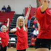 Led by St. Anthony Bellettes dance team, Lil'ettes dancers perform at half-time of the St. Anthony-Charleston game during opening night of the St. Anthony Thanksgiving Tournament.