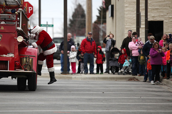 Viewers watch Santa disembark from a fire truck Saturday during Old Fashioned Christmas in front of the old courthouse.