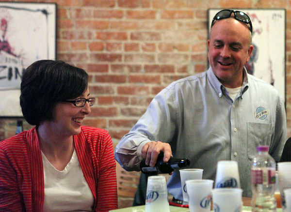 "Troy Greene, a sales manager for Koerner Distributor Inc., pours a Blue Moon for Amanda McKay, director of the Helen Matthes Library, at The Village Wine Shop during a Beer 101 class led by Mike Hagan. The class is one of many hosted by the library. ""People are being responsible, they're having fun, and they're learning something,"" Greene said."