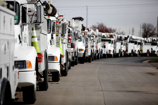 Utility vehicles from Kansas City Power and Light line up outside Petro gas station to refuel before heading to Milford, Conn., to help bring power back to Superstorm Sandy victims.