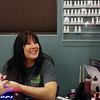 "Laynae Goodman, a nail technician at Branches Massage & Spa, smiles at a co-worker as she paints Tammy Stewart's nails during Taste of Branches. The event offered several sample services for $10 each and had a number of vendors from the community. Though Taste of Branches was listed as beginning at 5 p.m., Jennifer Waggoner, part owner and massage therapist, said they began taking people at 3 p.m. to accomodate as many as possible. ""It's amazing, the turnout we've had,"" she said."