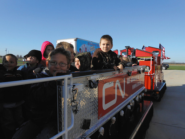 Kindergarten students take a small train ride at Early Learning Center in Effingham as they learn about train safety.
