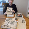 Kay Halford of rural Effingham shows off some news clippings related to the assassination of President John F. Kennedy.