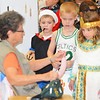 Kaye Kimpling, left, made balloon animals at St. Anthony Halloween Carnival held in the high school gym. Looking on are kindergarteners Jackson Schultz, Jack Johnson and Madeleine Lidy.