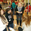 Effingham High School seniors Olivia Miller, far left, and Gabby Collier listen to instructions from Effingham Guidance Counselor Jennifer Patton about packing boxes of donated food. A food drive competition was held recently between grades, called the FISH Food Fight.