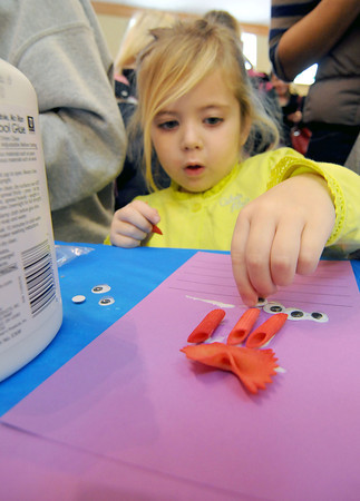 "Three-year-old Adilyn Schnarre of Altamont gives ""Eyeball"" its final set of eyes at the Monster Mash activity table at the Effingham Performance Center."