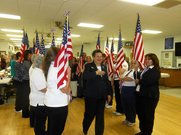 "National President of the Ladies Auxiliary to the VFW Armithea ""Sissy"" Borel walks down the aisle of honor at a dinner at VFW Post 1769 in Effingham. Borel is on a nationwide tour after being elected president of the organization in July."