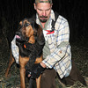 Ron Slifer harnesses Ronnie James Dio, his 20-month-old bloodhound prior to tracking a wounded deer Tuesday evening near the Mason/Edgewood township borders. The duo form Slifer's Bloodhound Service which tracks wounded deer for hunters.