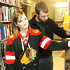 Jessa Bertinetti and Matt Friedrich of Tinley Park browse through some of the thousands of offerings at the Helen Matthes Library book sale in Effingham recently.