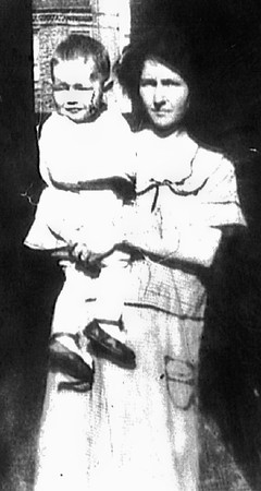 "Young mother Margaret ""Maggie"" Donaldson took in foster children from time to time. Here, she is pictured with a little girl known only as Mildred."