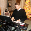Organist Scott Gercken provided a musical backdrop Saturday for the annual presentation of Christmas trees at the Wright Mansion in Altamont. Volunteers will have the home open from 1 to 4 p.m. each of the next two weekend afternoons. The 124-year-old home is decorated with 18 trees provided by various local businesses and organizations. Admission is free, though donations are accepted.