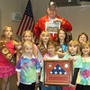 A flag that was flown over Afghanistan was presented to Girl Scout Troop 2390 at the Girl Scout Cabin in Effingham. The troop heard from veteran Darrell Schwerman about the significance of Veterans Day and the flag, which was sent back by Marine Sgt. Matt Nothaft, who has a relative in the troop. Also pictured, front row, are Madison Meyers, Kaylie McElroy, Maggie Jenkins and Ember Hutson; back row, Megan Jenkins, Rachel Graves, Grace Mason, Cadence Florida and Sydney Harvey.