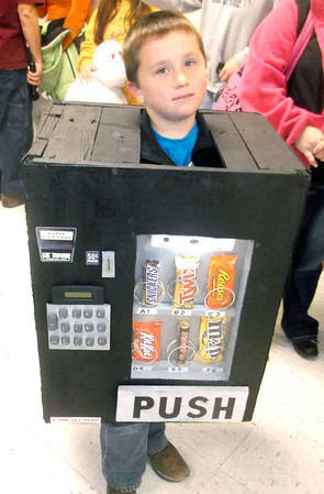Carson Taylor, a second-grader in the Cowden-Herrick school district, portrays a candy machine during the annual Stewardson Halloween Costume Contest and Raffle sponsored by Stewardson American Legion Post 611.