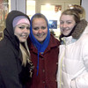 Ramsey High School family and consumer science teacher Dianna Wright is flanked by Ramsey seniors Morgan Dubiel, left, and Jessica Hoyle at the front door to the Effingham Kohl's store. The ladies, who had been standing in line for five hours, led a line of more than 350 people that streamed into the store once it opened at 8 p.m. Thursday. Kohl's was one of a number of stores that turned Black Friday into Black Thursday by opening at various times on Thanksgiving Day.