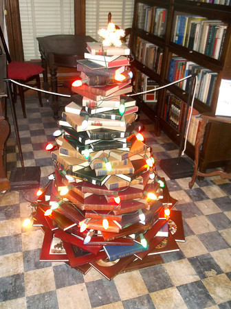 """This """"tree"""" consists of a carefully balanced display of books sponsored by the Altamont Public Library. It is one of 18 trees on display at the Wright Mansion in Altamont. The house will be open from 1 to 4 p.m. Nov. 30, Dec. 1,7 and 8."""