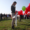"St. Anthony high school student Christa Kabbes holds part of a rosary made from balloons at the St. Anthony High School soccer field. The rosary was launched to celebrate the ""Year of Faith"" announced by Pope Benedict XVI."