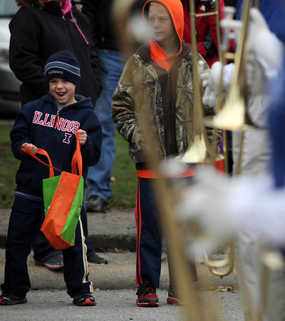 """An onlooker dances to a local drumline during the Halloween Parade. This year's theme was """"Superheroes in Action."""""""