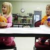 "Sadie Colnar, left, and Lena Fehrenbacher decorate pumpkins as a part of the Wiggles and Giggles program through the Effingham Park District. Jennifer Colnar, mother of Sadie, said of the program, ""It's wonderful that we have this in our community. It's hard to find things for 3-, 4- and 5-year-olds to do."""