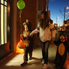 From left, Zachary Brown, Angie Tanner and Joel Brown walk downtown during Effingham's first Downtown Safe Trick or Treating. Tanner, the boys' babysitter.