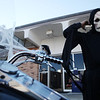Mike Brooks pulls on his skull mask before getting on his spookily-decorated motorcycle on Banker Street. Brooks said he dresses up his bike for several holidays.