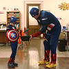 Attorney Scott Ealy, dressed as Captain America, offers candy to miniature Captain America Justin Brummer, 8, during the Effingham Downtown Safe Trick-or-Treating. Sixteen downtown businesses stayed open late to allow trick-or-treaters and their parents to stay off potentially more dangerous streets.