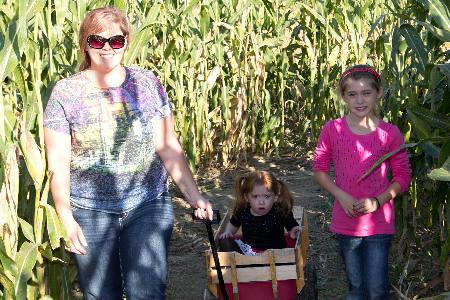 Kelly Langford led her niece, Adriana Gordon, and her daughter, Brooklyn Rogers (in wagon), around the corn maze at St. Paul Lutheran Church, north of Dieterich.