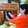 Barb Storm organizes one of the many free books offered at her house through the growing organization Little Free Library.