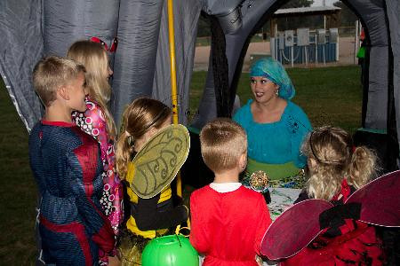 Deedra Myers of Effingham reads the fortune of many young ghouls and goblins at Happy Hauntings haunted walk at Hendelmeyer Park.