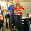 From back, Austin McWhorter of Teutopolis and Zach Haake, Brian Clough and<br /> Katie Tegeler, all from Effingham, listen to a presentation in the engineering office at Versatech LLC in Effingham. The students toured a number of local manufacturing enterprises during a daylong tour.