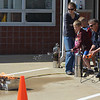 Elliot Huber, 9, of Dieterich puts out a blaze with the help of firefighter Tom Vogt at the Effingham Fire Department Open House recently. Along with the fire extinguisher demonstration, the event also featured station tours, the fire safety house and a practice 911 call.