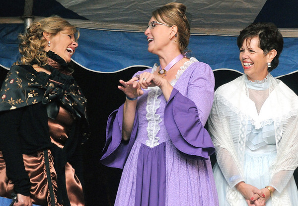 "Karen Brumleve, Patti Ruholl and Janet Dhom share a moment of laughter recounting Ruholl's choice of jewelry over a television as a reward for her participation in being a ""First Lady"" ambassador during Teutopolis' sesquicentennial celebration 25 years ago. Former First Ladies were introduced at the Oktoberfest event at Teutopolis Knights of Columbus. The event kicked off Teutopolis' 175th celebration activities."