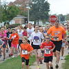 Runners take off at the Gettin' Out the Door 5K Run/Walk Event in Effingham Saturday. The second annual event is run by the Alliance for a Healthier Effingham County and the Effingham County Chamber of Commerce.