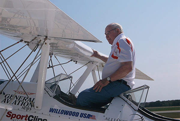 Larry Long, a World War II veteran, sits in a plane he was able to fly around Effingham in, free of charge.