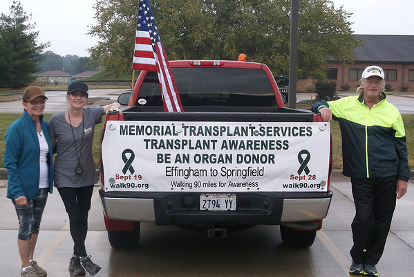 Don Stuckey, of Beecher City, took one last minuet to relax as he leaned on the side of his truck before his 90 mile trek to Springfield to raise money and awareness for organ donation. Stuckey had his kidney replaced two-months ago after years of dialysis. Also pictured from left are his mother Fay Stuckey, and sister Linda Hollinshead.