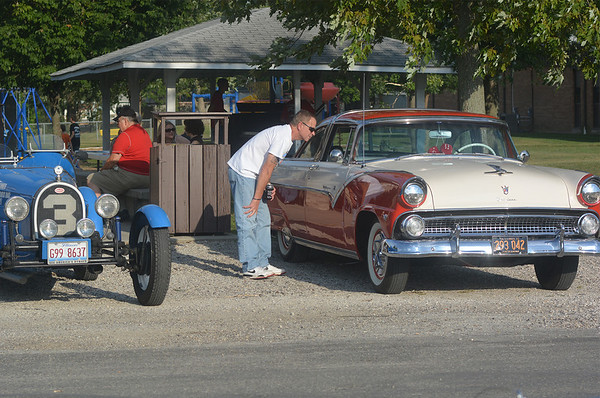 Robert Barnick of Teutopolis looks at some of the cars at a cruise in recently at Dieterich Liberty Memorial Park. Drivers have been bringing unique cars to the park for the last three years.