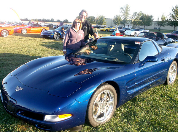 Karen and Michael McKanna of Michigan City, Ind., show off their 2004 Corvette at the annual Mid America Motorworks Corvette Funest. The McKannas have been to the annual event several times.