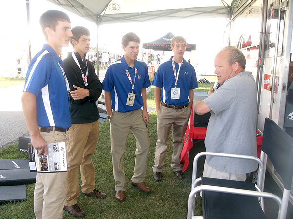 Bill Jonson of Brute Industries in Escanaba, Mich., talks sales strategies with budding businessmen, from left, Aaron Goeckner of Altamont, Jackson Wendling of Effingham High School, Garrett Ziegler of Altamont, and Sean Sandifer of EHS at the annual Corvette Funfest. The teens are all members of the Effingham County CEO class that attended the event.