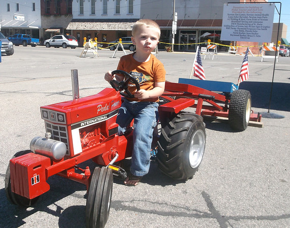Bentley Gorrell of Newton got the feel of the pedal tractor he would compete in during the 3- and 4-year-old age group at the Newton Fall Festival recently.