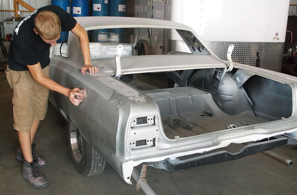 Probst Auto Body Employee Cody Michels does body work on a<br /> 1964 Chevrolet Impala. The vehicle is undergoing a total renovation,<br /> including new paneling, sanding and painting.