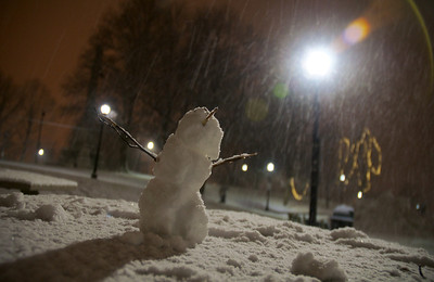 122912, Boston, MA - A snowman hails the coming of the building blocks of life from a picnic table in Boston Common on Saturday night. Herald photo by Ryan Hutton
