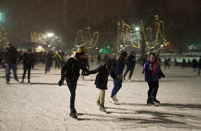 122912, Boston, MA - People enjoy the snow by skating a few laps around the rink at the Frog Pond in Boston Common. Herald photos by Ryan Hutton
