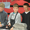 From left, Jack Elder, Aidan Steineman and Sutherlan Litke show off their blacksmith skills.