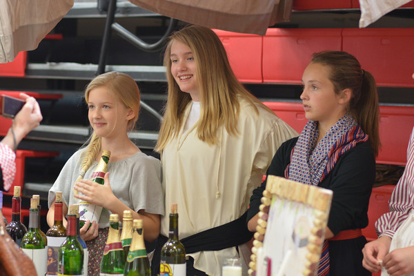 From left, Caroline Deters, Taylor Beesley and Avery Rogers at St. Anthony Renaissance Fair Thursday.