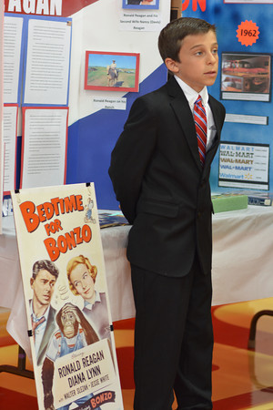 Zach Wortman portrays Ronald Reagan during St. Anthony Grade School wax museum Thursday.