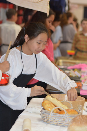 April Dy is among the breadmakers at St. Anthony Grade School Renaissance Fair Thursday.