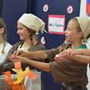 From left, Makenna Grubb, Claire Scheidemantel, Audrey Niebrugge and Claire Lustig demonstrate during St. Anthony Grade School Renaissance Fair.
